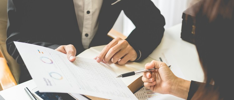 client with lawyer having face-to-face meeting